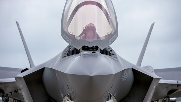Maj. Will Andreotta, F-35 Lightning II Heritage Flight Team pilot from Luke Air Force Base, Az., prepares to exit the cockpit at Joint Base Andrews, Md., Sept. 20, 2016. The aircraft is here to perform a fly-over during the U.S. Air Force Tattoo at Joint Base Anacostia-Bolling, Washington, D.C., Sept. 22, 2016.  - Sputnik International