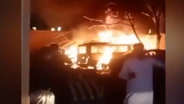 A screenshot from a video showing the aftermath of a blast that hit a parking lot at the Serena hotel in Pakistan - Sputnik International