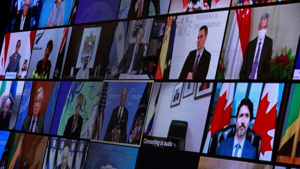 World leaders appear on screen during a virtual Climate Summit, seen from the East Room at the White House in Washington, U.S., April 22, 2021. - Sputnik International
