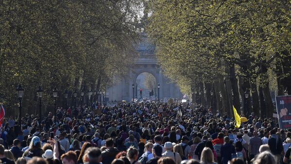 Demonstrators march during an anti-lockdown 'Unite for Freedom' protest, amid the spread of the coronavirus disease (COVID-19), in London, Britain, April 24, 2021 - Sputnik International