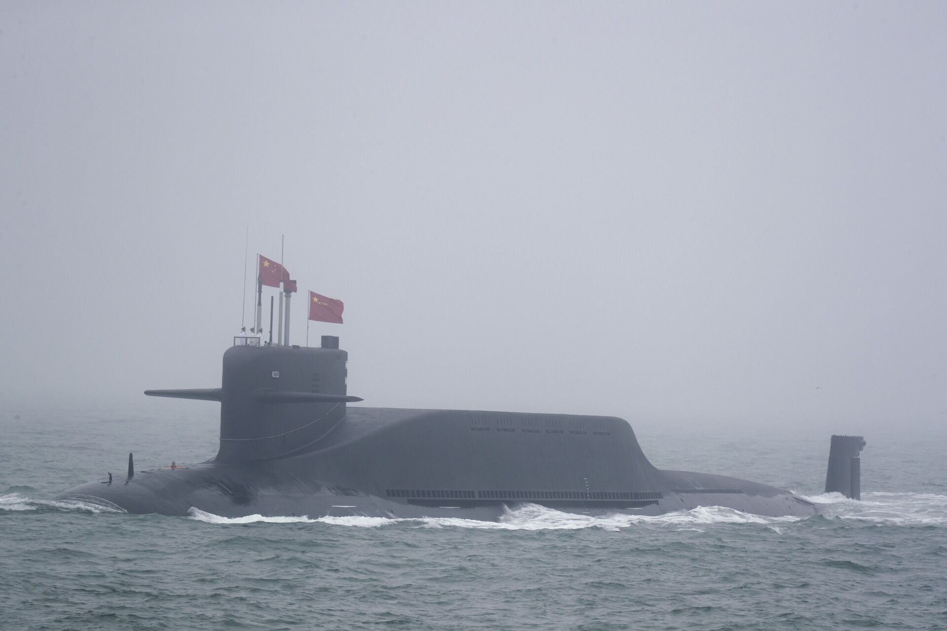 A new type 094A Jin-class nuclear submarine Long March 10 of the Chinese People's Liberation Army (PLA) Navy participates in a naval parade to commemorate the 70th anniversary of the founding of China's PLA Navy in the sea near Qingdao in eastern China's Shandong province, Tuesday, April 23, 2019 - Sputnik International, 1920, 08.10.2021