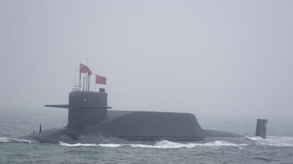 A new type 094A Jin-class nuclear submarine Long March 10 of the Chinese People's Liberation Army (PLA) Navy participates in a naval parade to commemorate the 70th anniversary of the founding of China's PLA Navy in the sea near Qingdao in eastern China's Shandong province, Tuesday, April 23, 2019 - Sputnik International