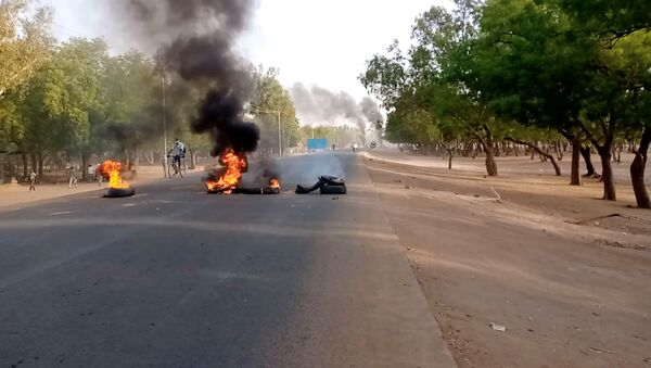 Tires burn at a fire barricade during protests demanding a return to civilian rule in N'Djamena, Chad 27 April 2021 in this still image obtained from social media video.  - Sputnik International