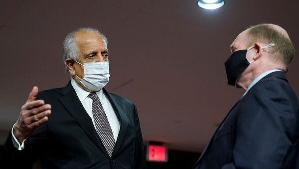 Zalmay Khalilzad, special envoy for Afghanistan Reconciliation, talks with U.S. Senator Chris Coons (D-DE), before the start of a Senate Foreign Relations Committee hearing on Capitol Hill in Washington, U.S., April 27, 2021. - Sputnik International