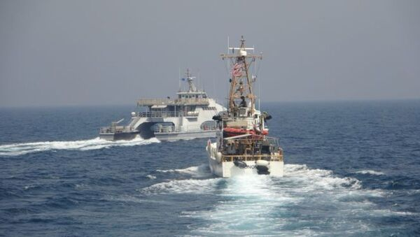 ARABIAN GULF (April 2, 2021) Iran's Islamic Revolutionary Guard Corps Navy (IRGCN) Harth 55, left, conducted an unsafe and unprofessional action by crossing the bow of the Coast Guard patrol boat USCGC Monomoy (WPB 1326), right, as the U.S. vessel was conducting a routine maritime security patrol in international waters of the southern Arabian Gulf, Apr. 2. The USCGC ships are assigned to Patrol Forces Southwest Asia (PATFORSWA), the largest U.S. Coast Guard unit outside the United States, and operate under U.S. Naval Forces Central Command's Task Force 55. - Sputnik International