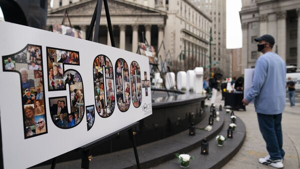 Demonstrators gather beside a presentation depicting the number 15,000 to denote estimated nursing home deaths, before a rally decrying New York Governor Andrew Cuomo's handling of the previous year's outbreak of COVID-19, in New York. - Sputnik International
