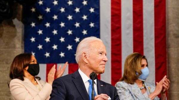 President Joe Biden addresses a joint session of Congress, with Vice President Kamala Harris and House Speaker Nancy Pelosi (D-Calif.) on the dais behind him, in Washington, U.S., April 28, 2021.    - Sputnik International