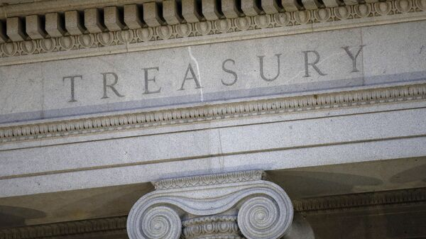 This June 6, 2019, file photo shows the U.S. Treasury Department building at dusk in Washington.  The U.S. Treasury has removed Vietnam and Switzerland from the list of nations labeled as currency manipulators, reversing a decision made by the Trump administration in December - Sputnik International