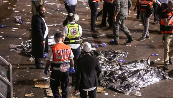 Medics and rescue workers attend to the Lag B'Omer event in Mount Meron, northern Israel, where fatalities were reported among the thousands of ultra-Orthodox Jews gathered at the tomb of a 2nd-century sage for annual commemorations that include all-night prayer and dance, at Mount Meron, Israel April 30, 2021 - Sputnik International
