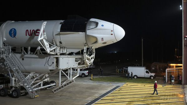 In this Monday, Nov. 9, 2020 photo provided by NASA, a SpaceX Falcon 9 rocket and Crew Dragon capsule is rolled out of the horizontal integration facility at Launch Complex 39A, as preparations continue for a crewed mission at NASA's Kennedy Space Center in Florida.  - Sputnik International