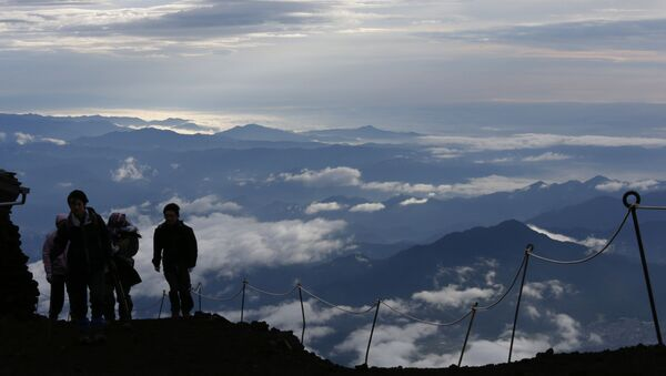 Climbers go up Mount Fuji, in Fujiyoshida city, Yamanashi prefecture, Japan, Thursday, July 4, 2013. Japan's most iconic landmark, Mount Fuji, the 3,776-meter-tall mountain was selected as a World Heritage site in June. - Sputnik International