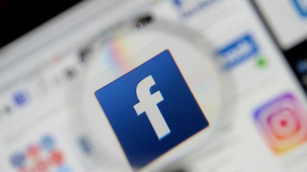 The Facebook logo is seen on a screen in this picture illustration taken December 2, 2019. - Sputnik International