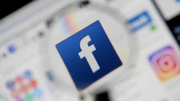 The Facebook logo is seen on a screen in this picture illustration taken 2 December 2019. - Sputnik International
