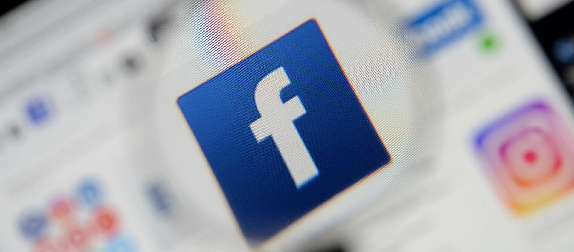 The Facebook logo is seen on a screen in this picture illustration taken December 2, 2019. - Sputnik International, 1920, 17.07.2021