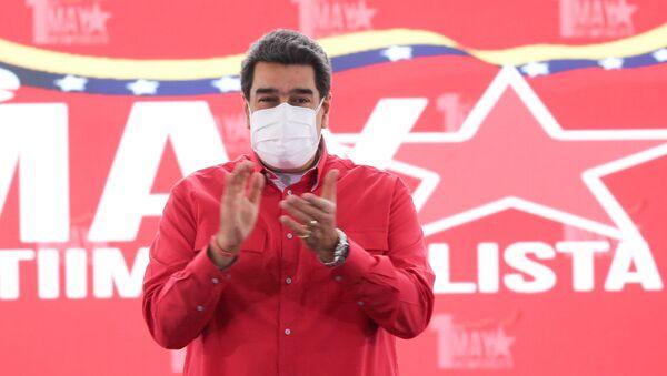 Venezuelan President Nicolas Maduro applauds during an event to mark May Day, in Caracas, Venezuela May 1, 2021. - Sputnik International