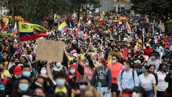 Demonstrators take part in a protest against the tax reform of President Ivan Duque's government in Bogota, Colombia, May 1, 2021. - Sputnik International
