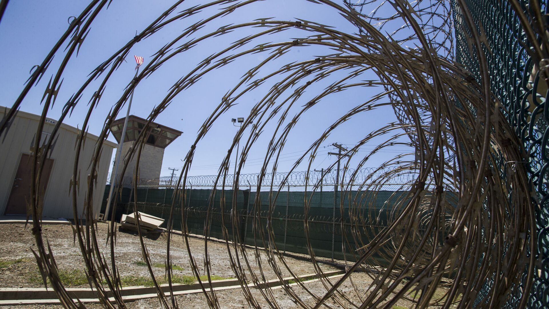 In this Wednesday, April 17, 2019 file photo reviewed by U.S. military officials, the control tower is seen through the razor wire inside the Camp VI detention facility in Guantanamo Bay Naval Base, Cuba. - Sputnik International, 1920, 07.10.2021