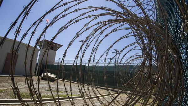 In this Wednesday, April 17, 2019 file photo reviewed by U.S. military officials, the control tower is seen through the razor wire inside the Camp VI detention facility in Guantanamo Bay Naval Base, Cuba. - Sputnik International
