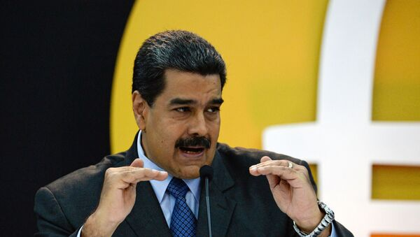 Venezuela's President Nicolas Maduro delivers a speach during a press conference to launch to the market a new oil-backed cryptocurrency called Petro, at the Miraflores Presidential Palace in Caracas, on February 20, 2018 - Sputnik International
