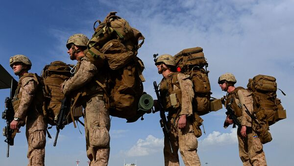 In this file photo taken on October 27, 2014, US Marines board a C-130J Super Hercules transport aircraft headed to Afghanistan's Kandahar as British and US forces withdraw from the Camp Bastion-Leatherneck complex at Lashkar Gah in Helmand province - Sputnik International