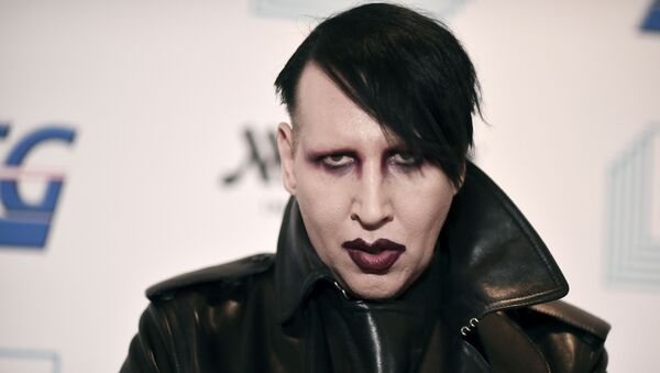 Marilyn Manson attends the 9th annual Home for the Holidays benefit concert in Los Angeles. Detectives are investigating Manson for allegations of domestic violence that reportedly occurred about a decade ago in West Hollywood, authorities said. The domestic violence is believed to have occurred between 2009 and 2011, when Manson lived in the city of West Hollywood. - Sputnik International