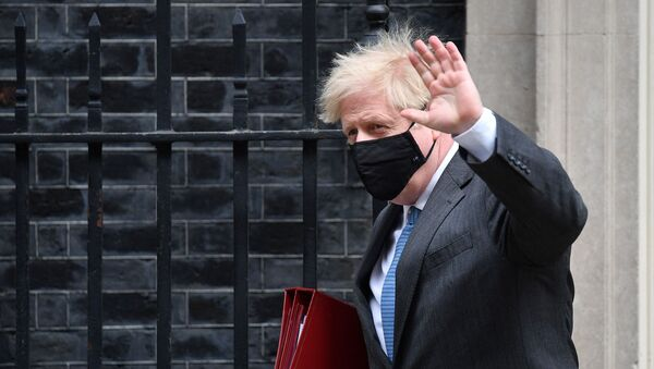 Britain's Prime Minister Boris Johnson leaves 10 Downing Street in central London on April 28, 2021, to take part in the weekly session of Prime Minister's Questions (PMQs) at the House of Commons - Sputnik International