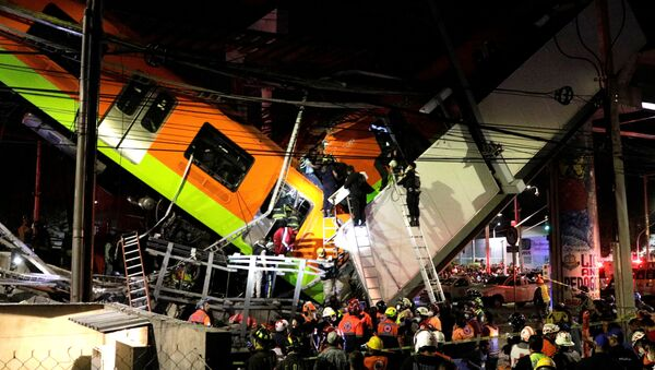 Rescuers work at a site where an overpass for a metro partially collapsed with train cars on it at Olivos station in Mexico City, Mexico May 03, 2021.  - Sputnik International