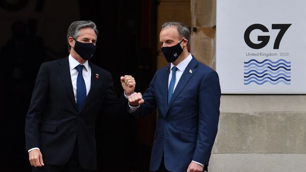 US Secretary of State Antony Blinken (L) is greeted on arrival by Britain's Foreign Secretary Dominic Raab at the start of the G7 foreign ministers meeting in London on May 4, 2021 - Sputnik International