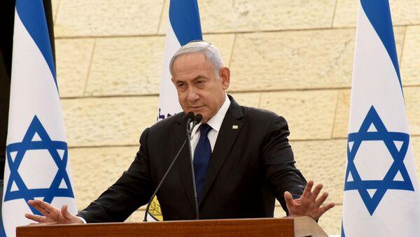 Israeli Prime Minister Benjamin Netanyahu speaks at a ceremony for fallen soldiers of Israel's wars at the Yad Lebanim House on the eve of Memorial Day, in Jerusalem, April 13, 2021 - Sputnik International