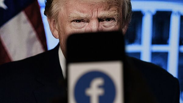 In this photo illustration, a phone screen displays a Facebook logo with the official portrait of former US President Donald Trump on the background, on May 4, 2021, in Arlington, Virginia. - Facebook's independent oversight board was set for a momentous decision on the platform's ban of former US president Donald Trump, as debate swirls on the role of social media in curbing hateful and abusive speech while controlling political discourse. - Sputnik International