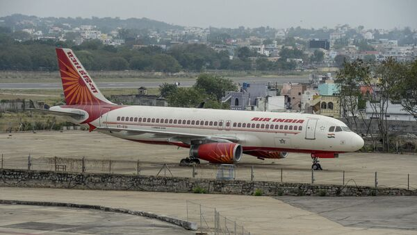 A security personnel stands guard near an Air India Airbus A-320  displayed at Begumpet Airport in Hyderabad on March 14, 2020. - Sputnik International