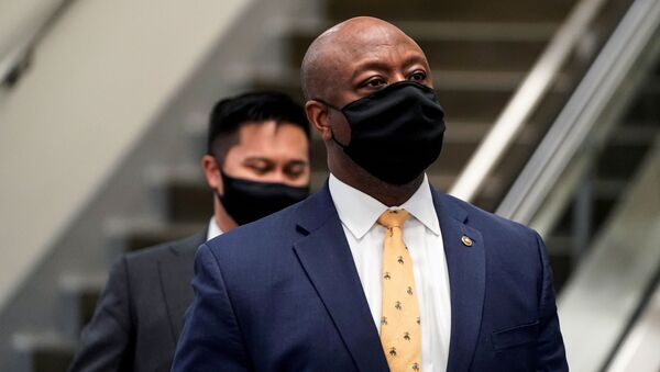 U.S. Senator Tim Scott (R-SC) departs after House impeachment managers rested their case in impeachment trial of former U.S. President Donald Trump, on charges of inciting the deadly attack on the U.S. Capitol, on Capitol Hill in Washington, U.S., February 11, 2021. - Sputnik International