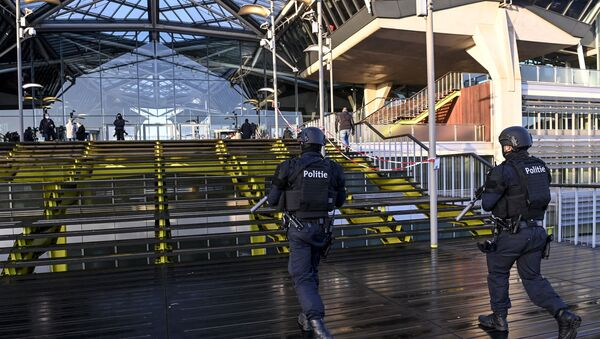 Heavily armed policemen patroll outside the courthouse during the trial of four persons including an Iranian diplomate and Belgian-Iranian couple before the Antwerp criminal court in Antwerp, on February 4, 2021. - A Belgian court returns a verdict on February 4, 2021, in the trial of an Iranian diplomat accused of plotting a bomb attack against opposition activists meeting in France. Assadollah Assadi, a 49-year-old formerly based in Vienna, faces up to 20 years in prison if convicted of plotting to target the June 30, 2018 rally. The gathering in Villepinte outside Paris included senior leaders of the exiled National Council of Resistance in Iran (NCRI) and some high-profile supporters.  - Sputnik International
