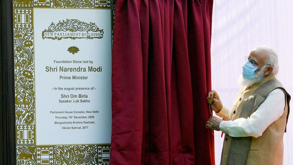 This handout photograph taken on December 10, 2020 and released by the Indian Press Information Bureau (PIB), shows India's Prime Minister Narendra Modi unveiling the plaque to lay the foundation stone of the new parliament building in New Delhi. - Sputnik International