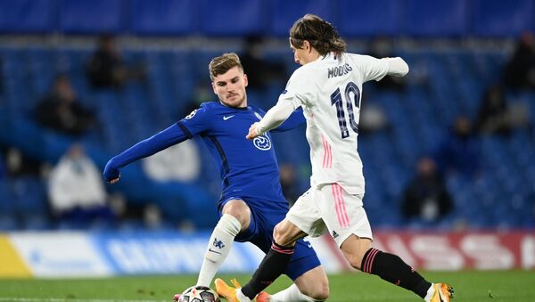 Soccer Football - Champions League - Semi Final Second Leg - Chelsea v Real Madrid - Stamford Bridge, London, Britain - May 5, 2021 Chelsea's Timo Werner in action with Real Madrid's Luka Modric - Sputnik International