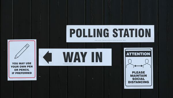 Signs pointing the way to a polling station and advising voters to maintain social distancing are seen at Fulwell Mill ahead of local elections, amid the coronavirus disease (COVID-19) pandemic, in Sunderland, Britain May 6, 2021.  - Sputnik International