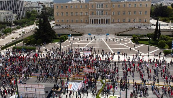 Members of the Greek Labour Union (PAME) protests past the Hellenic Parliament during a strike against the new Labour law, in central Athens on May 6, 2021.  - Sputnik International