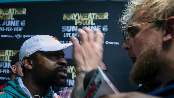 Floyd Mayweather (L) and Jake Paul confront each other during a press conference at Hard Rock Stadium, in Miami Gardens, Florida, on May 6, 2021. - Former world welterweight king Floyd Mayweather said May 4,2021 he will face off against YouTube personality Logan Paul in an exhibition bout at Miami's Hard Rock Stadium on June 6, 2021. - Sputnik International