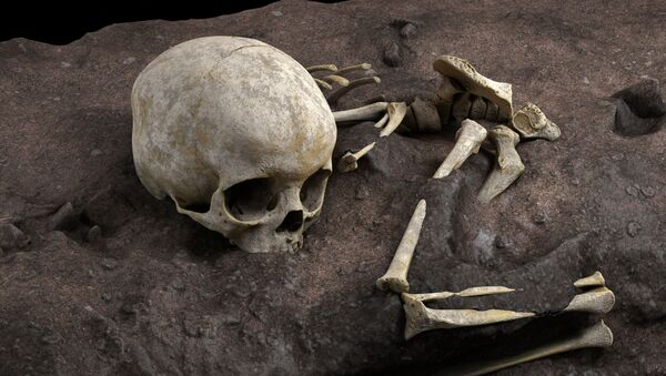 This handout computer-generated image released on May 4, 2021 by the CNRS-University of Bordeaux, shows the remains of a 3-year-old child named by the scientists Mtoto (meaning 'child' in Swahili) and buried inside a deliberately dug pit, were discovered by archaelogists. - The discovery of the oldest burial site in Africa, dated at 78,000 years old, has just been revealed in the journal Nature by an international team including several researchers from the CNRS - Sputnik International