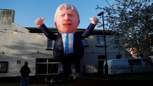An inflatable figure of Prime Minister Boris Johnson is seen outside Mill House Leisure Centre as ballots are being counted, in Hartlepool, Britain May 7, 2021 - Sputnik International