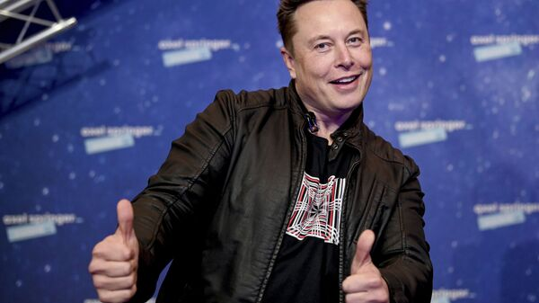 In this Tuesday, 1 December 2020 file photo, SpaceX owner and Tesla CEO Elon Musk arrives on the red carpet for the Axel Springer media award, in Berlin, Germany - Sputnik International