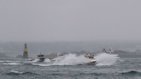 French fishing boats leave the Jersey waters following their protest in front of the port of Saint Helier off the British island of Jersey to draw attention to what they see as unfair restrictions on their ability to fish in UK waters after Brexit, on May 6, 2021. - Sputnik International