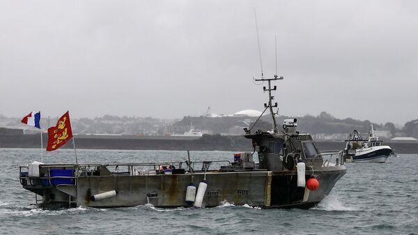 A French fishing boat, one of several, takes part in a protest in front of the port of Saint Helier off the British island of Jersey to draw attention to what they see as unfair restrictions on their ability to fish in UK waters after Brexit, on May 6, 2021. - - Sputnik International