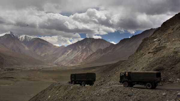 FILE- In this Sept. 14, 2017, file photo, Indian army trucks drive near Pangong Tso lake near the India China border in India's Ladakh area. The Indian army said Saturday, Jan. 9, 2020, that it has apprehended a Chinese soldier in the remote Ladakh region, where the two countries are locked in a monthslong military standoff along their disputed mountain border. An army statement said the Chinese soldier was taken into custody on Friday for transgressing into the Indian side in area South of Pangong Tso lake. (AP Photo/Manish Swarup) - Sputnik International