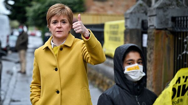 Scotland's First Minister Nicola Sturgeon shows a thumb-up gesture at Annette Street School polling station as Scotland's parliamentary election voting has begun, in Glasgow, Britain, May 6, 2021. - Sputnik International