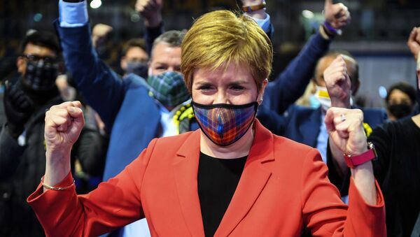 Scotland's First Minister and leader of the Scottish National Party (SNP), Nicola Sturgeon reacts after being declared the winner of the Glasgow Southside seat at Glasgow counting centre in the Emirates Arena in Glasgow on May 7, 2021, during counting for the Scottish parliament elections.  - Sputnik International