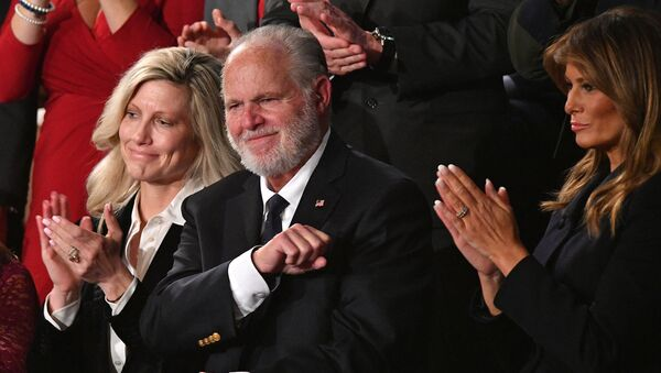 Radio personality Rush Limbaugh pumps his fist as he is acknowledged by US President Donald Trump as he delivers the State of the Union address at the US Capitol in Washington, DC, on February 4, 2020. - Sputnik International
