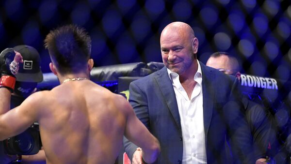 UFC President Dana White (R) congratulates Henry Cejudo (L) of the United States after defeating Dominick Cruz of the United States in their bantamweight title fight during UFC 249 at VyStar Veterans Memorial Arena on May 09, 2020 in Jacksonville, Florida. - Sputnik International