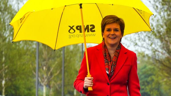 Scotland's First Minister and leader of the Scottish National Party (SNP), Nicola Sturgeon gestures on congratulating candidate Kaukab Stewart after she was elected MSP for Glasgow Kelvin in the Scottish Parliamentary Election, in Glasgow on May 8, 2021. - Sputnik International