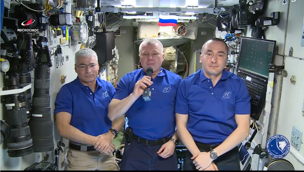 A screenshot from a video address by the ISS crew congratulating all for the 76th anniversary of the victory in World War II. - Sputnik International